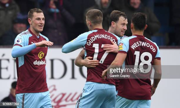 Chris Wood of Burnley celebrates scoring his side's second goal with team mates during the Premier League match between Burnley and Everton at Turf...