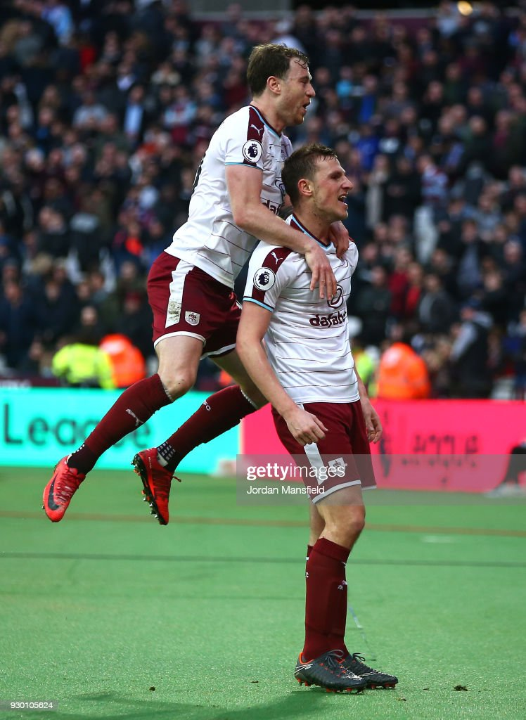 Chris Wood of Burnley celebrates scoring his side's third goal with Ashley Barnes during the Premier League match between West Ham United and Burnley at London Stadium on March 10, 2018 in London, England.