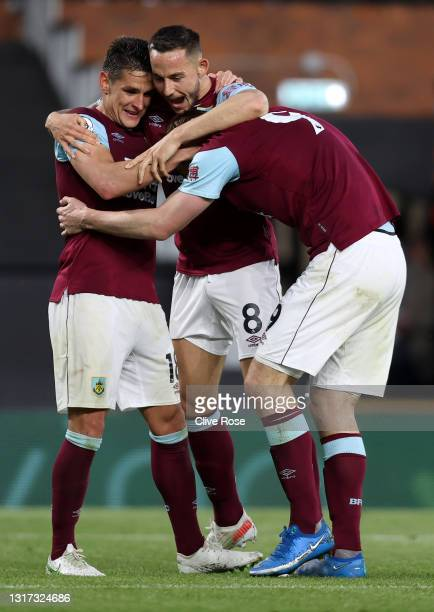 Chris Wood of Burnley celebrates with Ashley Westwood and Josh Brownhill after scoring their team's second goal during the Premier League match...