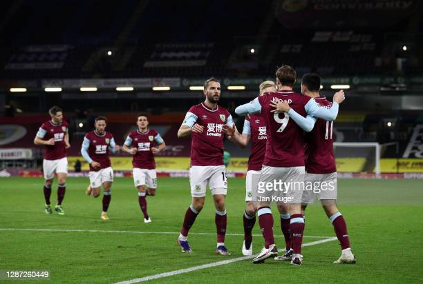 Chris Wood of Burnley celebrates with Jay Rodriguez and Dwight McNeil after scoring their team's first goal during the Premier League match between...