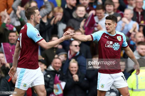 Chris Wood of Burnley celebrates with teammate Ashley Westwood after scoring his team's first goal during the Premier League match between Burnley FC...