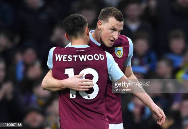 Chris Wood of Burnley celebrates with teammate Ashley Westwood of Burnley after scoring their team's first goal during the Premier League match...