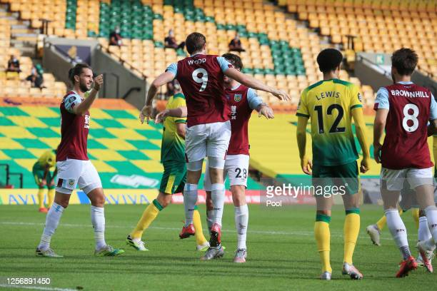 Chris Wood of Burnley celebrates with teammate Kevin Long after scoring his team's first goal during the Premier League match between Norwich City...
