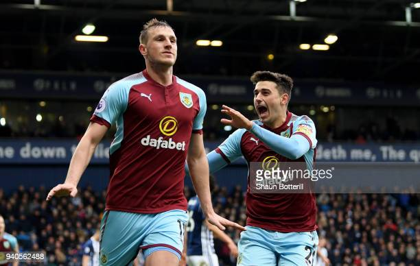 Chris Wood of Burnley celebrates with teammate Matthew Lowton after scoring his sides second goal during the Premier League match between West...