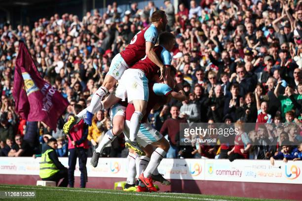 Chris Wood of Burnley celebrates with teammates after scoring his team's first goal during the Premier League match between Burnley FC and Tottenham...