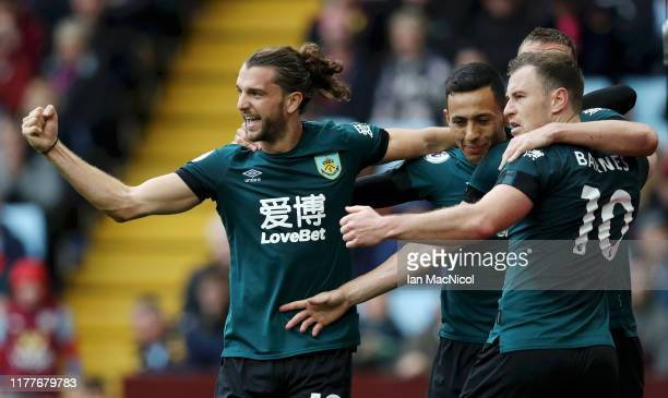 Chris Wood of Burnley celebrates with teammates after scoring his team's second goal during the Premier League match between Aston Villa and Burnley...