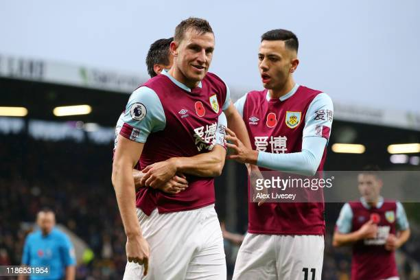 Chris Wood of Burnley celebrates with teammates after scoring his team's second goal during the Premier League match between Burnley FC and West Ham...