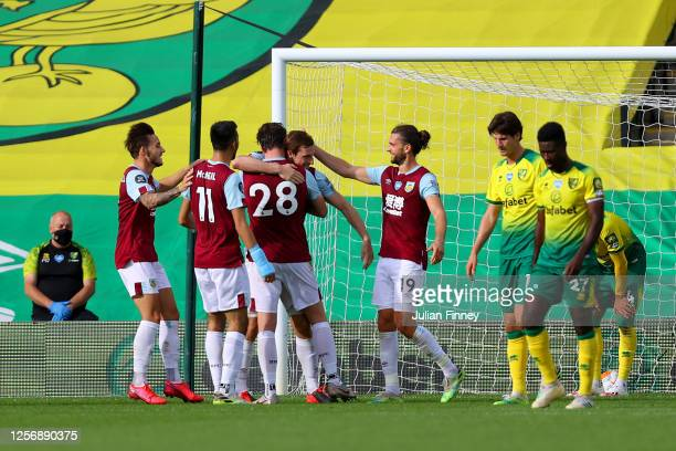 Chris Wood of Burnley celebrates with teammates after scoring his team's first goal during the Premier League match between Norwich City and Burnley...