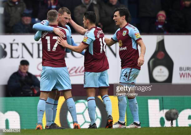 Chris Wood of Burnley celebrates with teammates after scoring his sides second goal during the Premier League match between Burnley and Everton at...