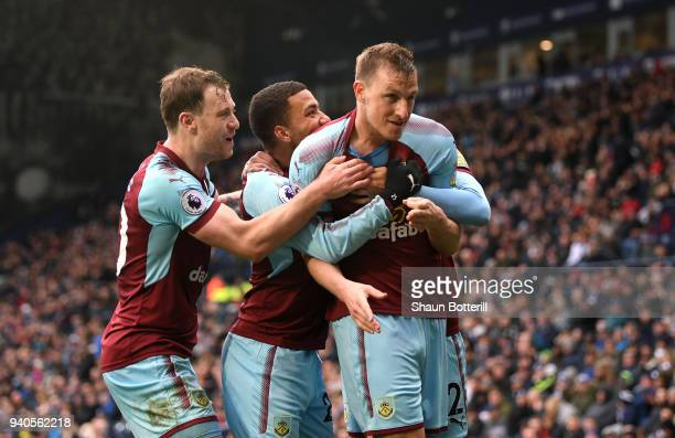 Chris Wood of Burnley celebrates with teammates Ashley Barnes and Aaron Lennon after scoring his sides second goal during the Premier League match...