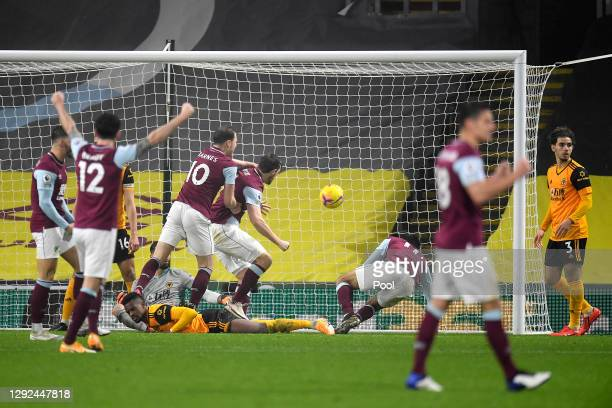 Chris Wood of Burnley celebrates with teammates Ashley Barnes, Robbie Brady and Dwight McNeil after scoring their team's second goal during the...