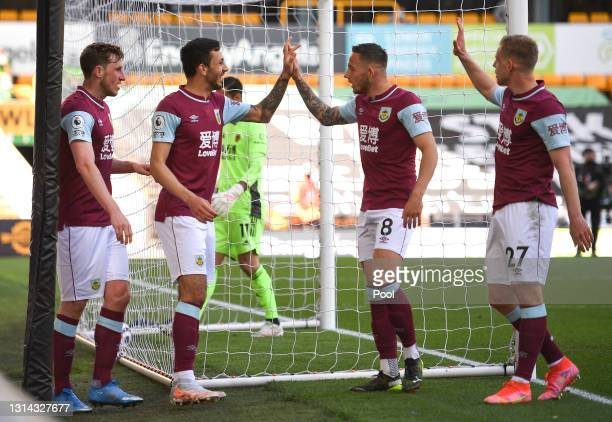 Chris Wood of Burnley celebrates with teammates Dwight McNeil, Josh Brownhill and Matej Vydra after scoring their team's second goal during the...