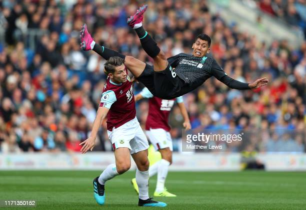 Chris Wood of Burnley clashes with Roberto Firmino of Liverpool during the Premier League match between Burnley FC and Liverpool FC at Turf Moor on...