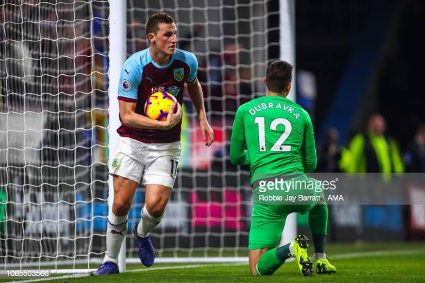 Chris Wood of Burnley collects the ball as Sam Vokes of Burnley scores a goal to make it 1-2 during the Premier League match between Burnley FC and...