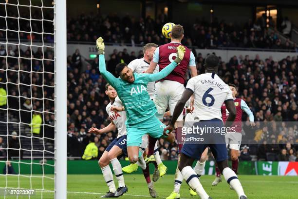 Chris Wood of Burnley contests a header with Paulo Gazzaniga of Tottenham during the Premier League match between Tottenham Hotspur and Burnley at...