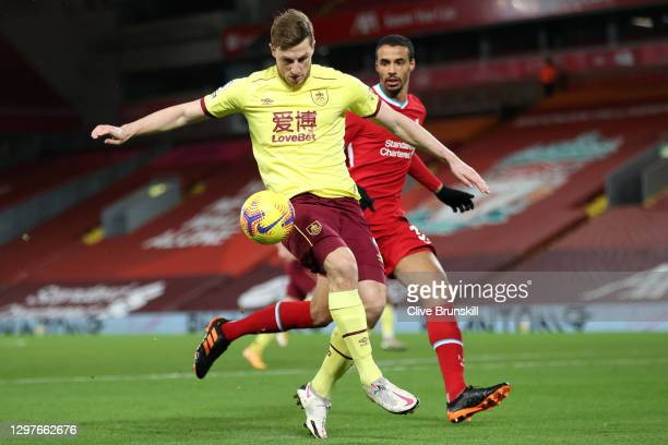 Chris Wood of Burnley controls the ball as he is closed down by Joel Matip of Liverpool during the Premier League match between Liverpool and Burnley...