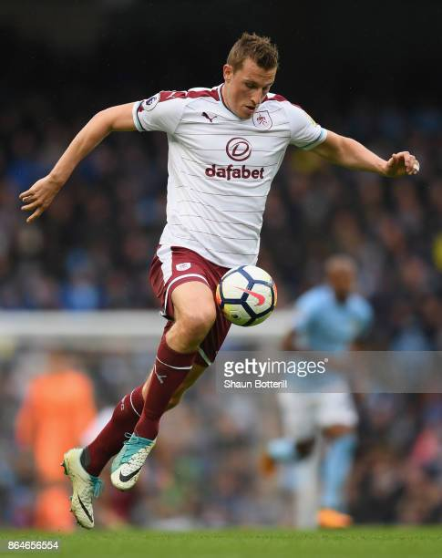 Chris Wood of Burnley controls the ball during the Premier League match between Manchester City and Burnley at Etihad Stadium on October 21 2017 in...