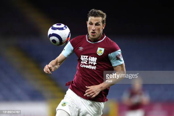 Chris Wood of Burnley in action during the Premier League match between Burnley and Liverpool at Turf Moor on May 19, 2021 in Burnley, England. A...