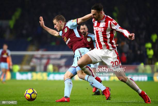 Chris Wood of Burnley is challenged by Geoff Cameron of Stoke City during the Premier League match between Burnley and Stoke City at Turf Moor on...