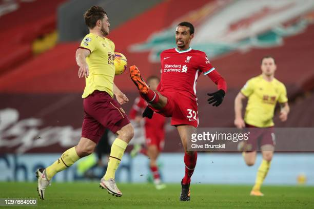 Chris Wood of Burnley is challenged by Joel Matip of Liverpool during the Premier League match between Liverpool and Burnley at Anfield on January...