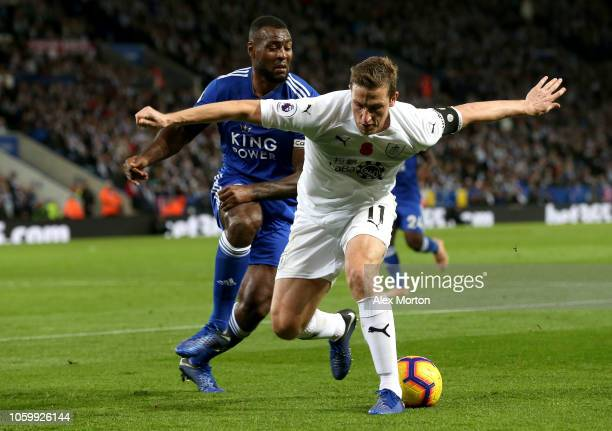 Chris Wood of Burnley is challenged by Wes Morgan of Leicester City during the Premier League match between Leicester City and Burnley FC at The King...