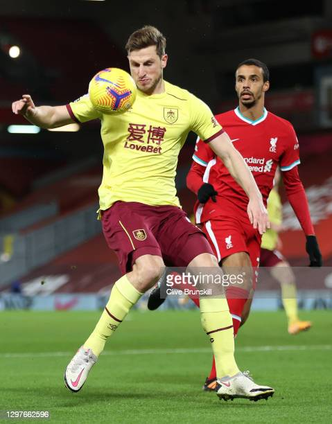 Chris Wood of Burnley is closed down by Joel Matip of Liverpool during the Premier League match between Liverpool and Burnley at Anfield on January...