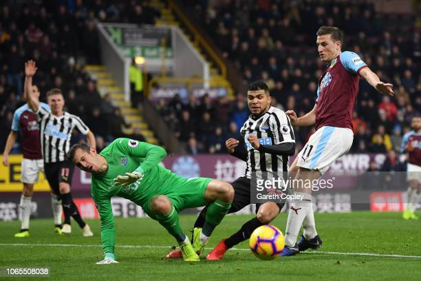 Chris Wood of Burnley is foiled by Deandre Yedlin and Martin Dubravka of Newcastle United during the Premier League match between Burnley FC and...
