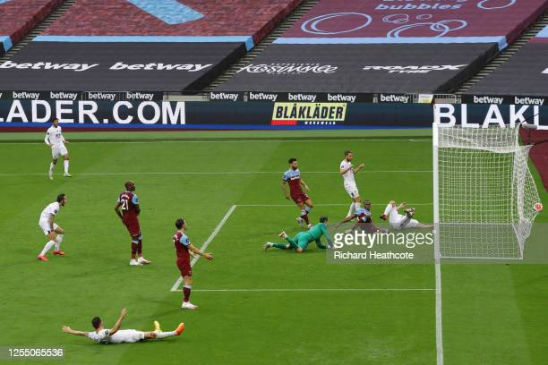 Chris Wood of Burnley scores but goal was ruled out by VAR as offside during the Premier League match between West Ham United and Burnley FC at...