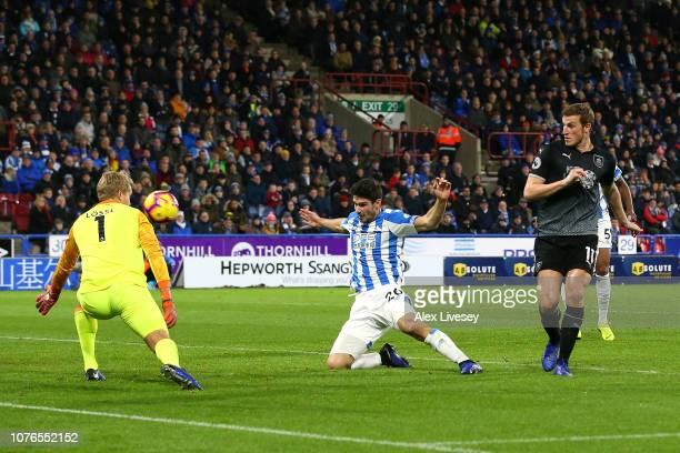 Chris Wood of Burnley scores his sides first goal past Jonas Lossl of Huddersfield Town during the Premier League match between Huddersfield Town and...