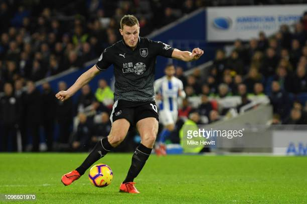 Chris Wood of Burnley scores his team's first goal during the Premier League match between Brighton Hove Albion and Burnley FC at American Express...