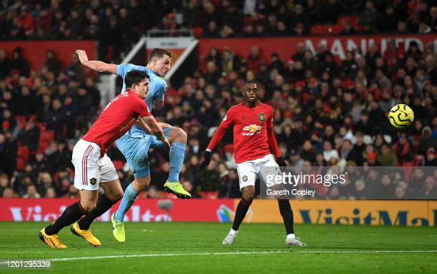 Chris Wood of Burnley scores his team's first goal during the Premier League match between Manchester United and Burnley FC at Old Trafford on...