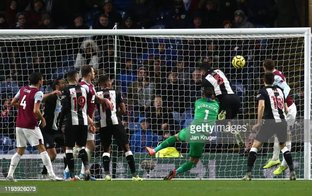Chris Wood of Burnley scores his team's first goal past Fabian Schar of Newcastle United and Martin Dubravka of Newcastle United during the Premier...