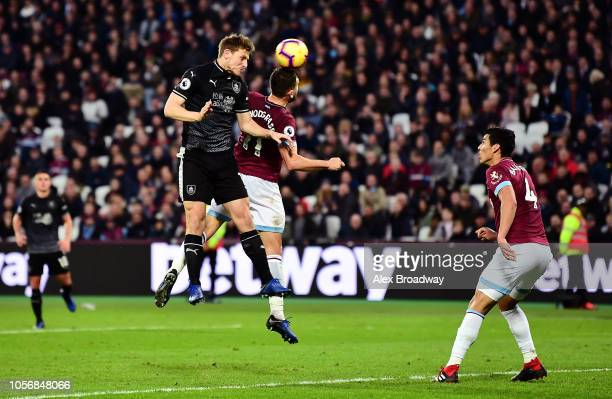 Chris Wood of Burnley scores his team's second goal during the Premier League match between West Ham United and Burnley FC at London Stadium on...