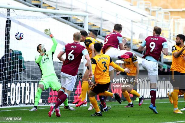 Chris Wood of Burnley scores their 3rd goal during the Premier League match between Wolverhampton Wanderers and Burnley at Molineux on April 25, 2021...