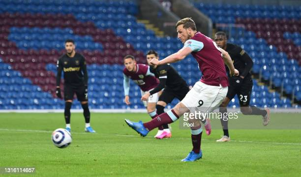 Chris Wood of Burnley scores their side's first goal from the penalty spot during the Premier League match between Burnley and West Ham United at...
