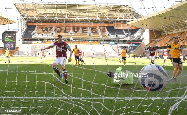 Chris Wood of Burnley scores their side's second goal past Rui Patricio of Wolverhampton Wanderers during the Premier League match between...