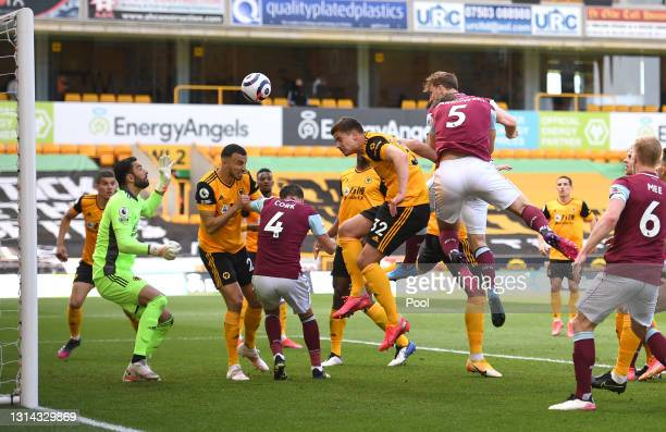 Chris Wood of Burnley scores their side's third goal past Rui Patricio of Wolverhampton Wanderers during the Premier League match between...
