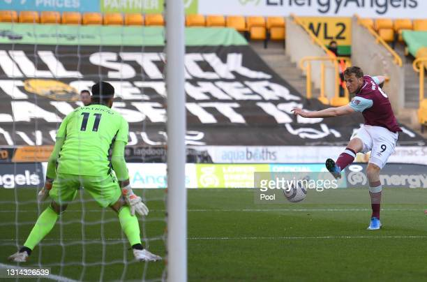 Chris Wood of Burnley scores their team's first goal past Rui Patricio of Wolverhampton Wanderers during the Premier League match between...
