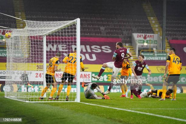Chris Wood of Burnley scores their team's second goal past Rui Patricio of Wolverhampton Wanderers during the Premier League match between Burnley...