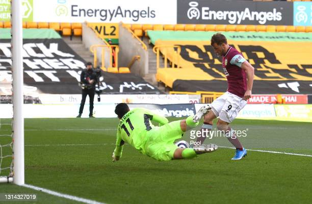 Chris Wood of Burnley scores their team's second goal past Rui Patricio of Wolverhampton Wanderers during the Premier League match between...