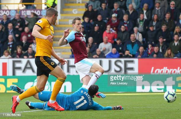 Chris Wood of Burnley shoots resulting in Conor Coady of Wolverhampton Wanderers scoring an own goal during the Premier League match between Burnley...