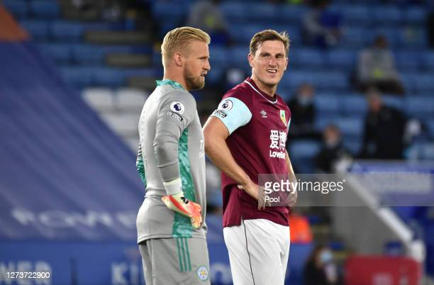 Chris Wood of Burnley speaks to Kasper Schmeichel of Leicester City during the Premier League match between Leicester City and Burnley at The King...
