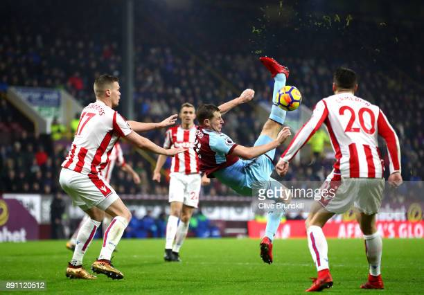 Chris Wood of Burnley tries an overhead kick past Ryan Shawcross of Stoke City during the Premier League match between Burnley and Stoke City at Turf...