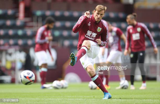 Chris Wood of Burnley warms up prior to the Premier League match between Burnley and Leeds United at Turf Moor on May 15, 2021 in Burnley, England....