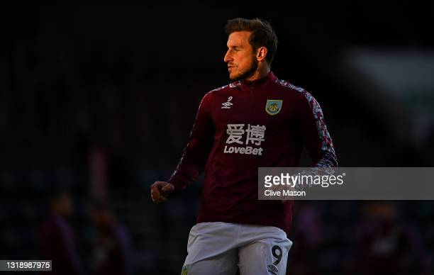 Chris Wood of Burnley warms up prior to the Premier League match between Burnley and Liverpool at Turf Moor on May 19, 2021 in Burnley, England.