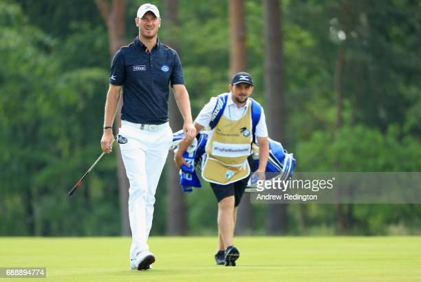 Chris Wood of England and his caddie Mark Crane walk on the 9th hole during day three of the BMW PGA Championship at Wentworth on May 27 2017 in...