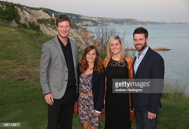 Chris Wood of England and his girlfriend Bethany Wivell pose for a photograph alongside Scott Jamieson of Scotland and his wife Natalie Jamieson...