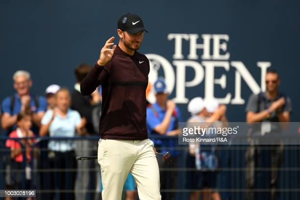 Chris Wood of England celebrates after putting for par on the 18th green during round three of the Open Championship at Carnoustie Golf Club on July...
