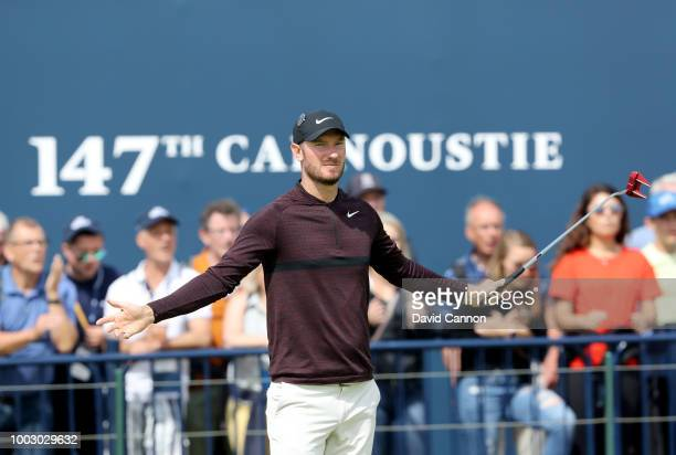 Chris Wood of England celebrates holing a long putt for par on the 18th hole during the third round of the 147th Open Championship at Carnoustie Golf...