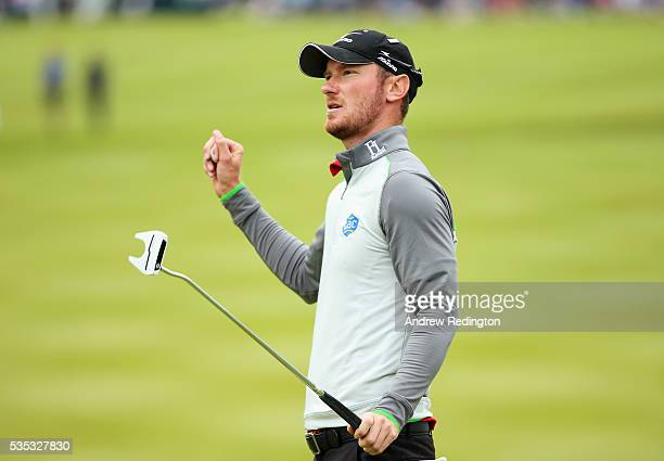 Chris Wood of England celebrates victory on the 18th green during day four of the BMW PGA Championship at Wentworth on May 29 2016 in Virginia Water...